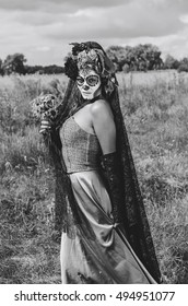 halloween make up sugar skull beautiful model with perfect hairstyle. Santa Muerte concept. Fashion retro toning. walks in the Park - the field