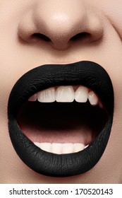 Halloween makeup. Expression rock style lip make-up like a vampire, dark romantic. Fashion look, black mat lips