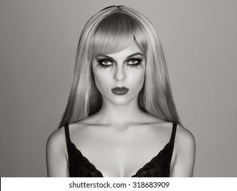halloween make-up sexy girl.young blond terrible woman
