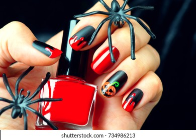 Halloween manicure design ideas. Halloween Nail art design. Nail Polish. Beauty hands. Trendy Stylish Colorful Nails and Nailpolish. Black matte nailpolish with blood drips and pumpkin.