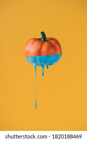 Halloween minimal concept with pumpkin and paint. Creative spooky holiday fun background