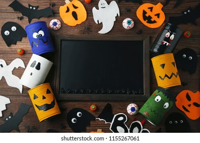 Halloween monsters with wooden frame on brown table