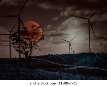 Halloween moon and sky concept from wind turbine construction in field and meadow look like cross with red moon with horror scene sky and cloudy background