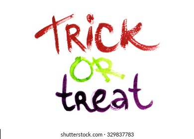 "Halloween motto ""Trick or treat"" written in watercolors on white isolated background"