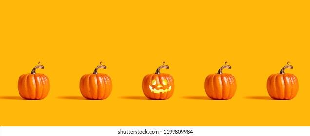 Halloween orange pumpkins on an orange background