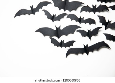Halloween paper bat decorations on a white background.
