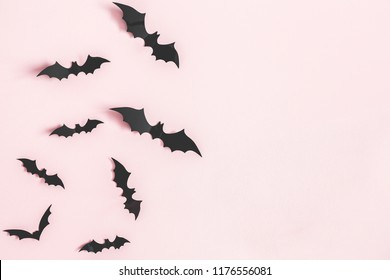 Halloween paper decorations on pastel pink background. Halloween concept. Flat lay, top view, copy space