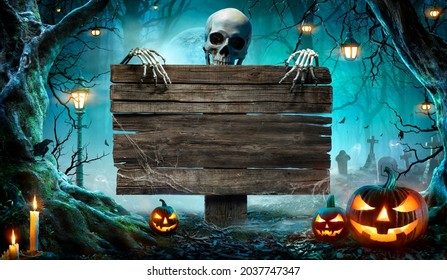 Halloween Party Card - Pumpkins And Skeleton In Graveyard At Night With Wooden Board  - Shutterstock ID 2037747347
