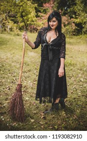 Halloween party concept, mysterious girl in black lace handmade dress. Beautiful young dark witch woman. Inspiration for halloween celebration, ideas and simple nice detail