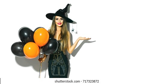 Halloween Party girl. Happy Halloween Sexy Witch holding black and orange  Air balloons. Beautiful 7a9ee2ba9611