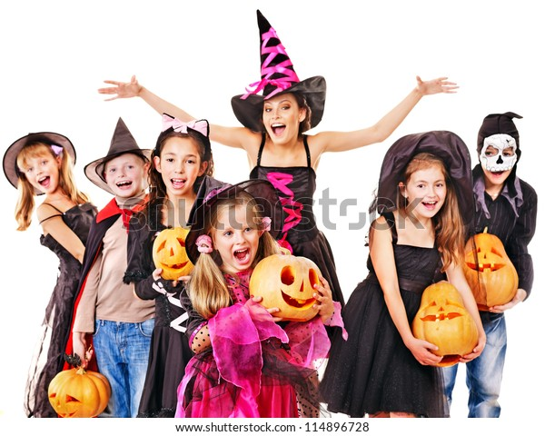 Halloween party with group children holding carving pumpkin.