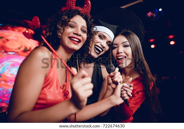 Halloween Party Three Girls Sexy Outfits Stock Photo (Edit