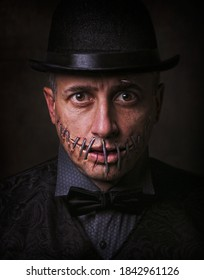 Halloween portrait of man with stiched mouth.