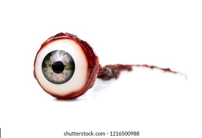 Halloween prop, decoration. Close up of ripped out eyeball isolated on white background