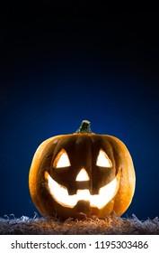 Halloween Pumpkin Burning with copy space. Dark background