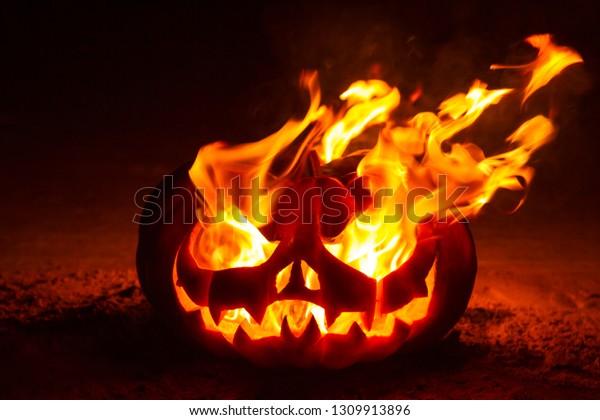 Halloween pumpkin burning at night