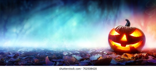 Halloween Pumpkin Burning In A Scary Forest At Night