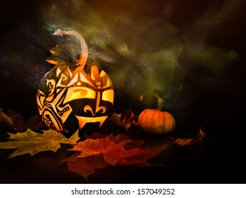 Halloween pumpkin with candle inside on black background, light brush technique