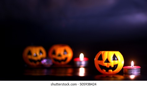 Halloween pumpkin with candlelight In A Mystic Forest At Night background
