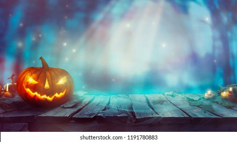 Halloween  with Pumpkin and Dark Forest. Scary Halloween Design on table