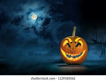 Halloween Pumpkin in Dark Forest. Spooky night Halloween background.