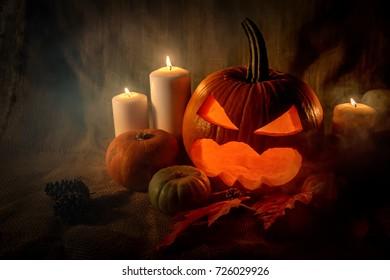 Halloween pumpkin head with burning candles