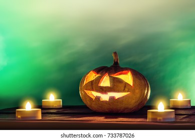 halloween pumpkin head with candle light in darkness spooky background, halloween background