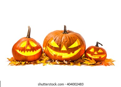 Halloween pumpkin head jack lantern with burning candles isolated on white background