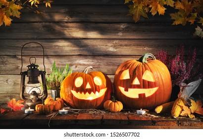 Halloween pumpkin head jack-o-lantern on wooden background