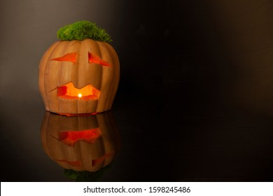 Halloween Pumpkin Jack O Latern on dark background. There is a place for text.