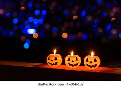 Halloween Pumpkin lamp, pumpkin lantern at night with beautiful bokeh, halloween concept.