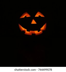 Halloween pumpkin lantern with black background. Traditional hand made decoration with candle on festive day.