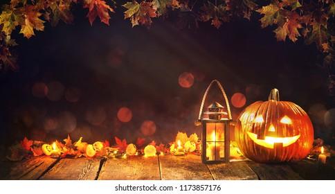 Halloween pumpkin with lantern on old wooden