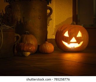 Halloween pumpkin lighting at doorsteps