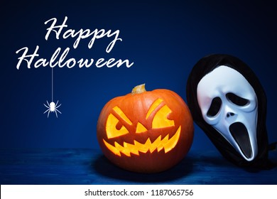Halloween pumpkin and mask with text on dark blue background.