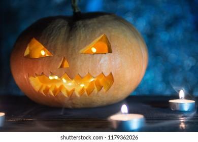 Halloween pumpkin monster in the smoke