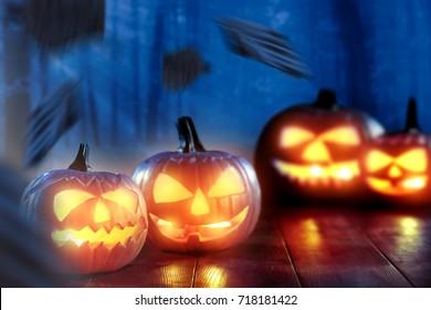 halloween pumpkin on desk and background of night