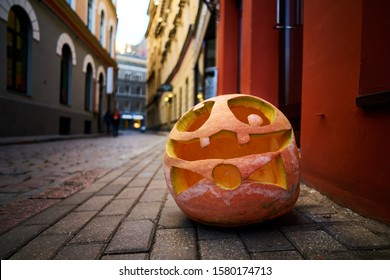 Halloween Pumpkin on old town street in Riga.