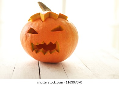 Halloween pumpkin on a white wooden surface