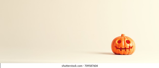 Halloween pumpkin ornament on an off white background