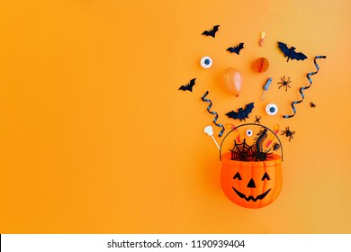 Halloween pumpkin with Halloween party objects, overhead view