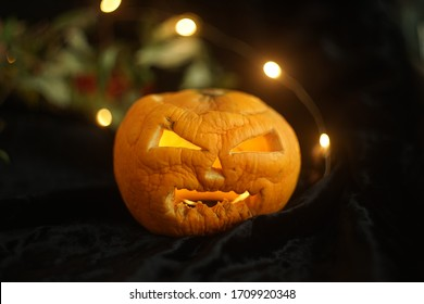 Halloween pumpkin with a scary face cut out