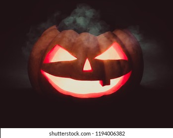Halloween pumpkin scary face Jack o Lanternon on dark background