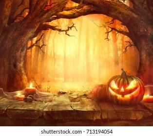 Halloween pumpkin. Scary pumpkin on table. Halloween background. Pumpkins in forest