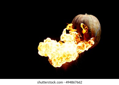 Halloween pumpkin is spewing fire flame flow on a black background is very impressive and colorful