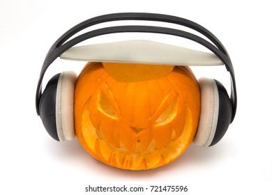 Halloween pumpkin wearing headphones