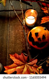 Halloween pumpkin,autumn leaves and candle light