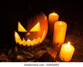 Halloween pumpkins with candles on black background