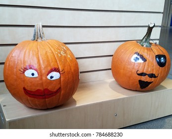 Halloween pumpkins with faces painted on