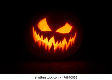 Halloween pumpkin's grin on black isolated background